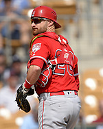 GLENDALE, ARIZONA - MARCH 04:  Jonathan Lucroy #20 of the Los Angeles Angels looks on against the Chicago White Sox on March 4, 2019 at Camelback Ranch in Glendale Arizona.  (Photo by Ron Vesely)  Subject:  Jonathan Lucroy