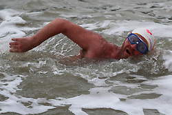 © Licensed to London News Pictures. 31/01/2015. Brighton, UK. Members of the Brighton and Hove Sea Swimming Club taking part in their daily exercise. A cold day in Brighton and the South Coast with temperatures expected to reach a maximum of 4C down the South Coast. Photo credit : Hugo Michiels/LNP