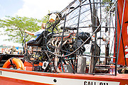 Boy age 12 sitting in drivers seat of fire dept. water rescue airboat. Aquatennial Beach Bash Minneapolis Minnesota USA