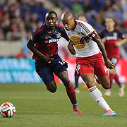 Thierry Henry, (right), New York Red Bulls, is challenged by Jhon Kennedy Hurtado, Chicago Fire, during the New York Red Bulls Vs Chicago Fire, Major League Soccer regular season match at Red Bull Arena, Harrison, New Jersey. USA. 10th May 2014. Photo Tim Clayton