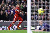 Football - Premier League - Liverpool vs. Stoke City<br /> Luis Suarez of Liverpool smiles as the ball crosses the line for his sides 2nd goal at Anfield