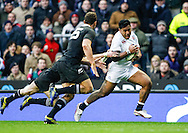 Picture by Andrew Tobin/SLIK images +44 7710 761829. 2nd December 2012. Manu Tuilagi from England escapes a tackle during the QBE Internationals match between England and the New Zealand All Blacks at Twickenham Stadium, London, England. England won the game 38-21.