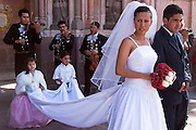 03 APRIL 2004 - SAN MIGUEL DE ALLENDE, GUANAJUATO, MEXICO: The bride and groom process out of the church after their wedding at the Iglesia Parroguia, the principal Catholic church in San Miguel de Allende, Mexico. San Miguel, which was founded in the 1600s, is one of Mexico's premier colonial cities. It has very strict zoning and building codes meant to preserve the historic nature of the city center. About 7,500 US citizens, mostly retirees, live in San Miguel. PHOTO BY JACK KURTZ