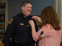 Detective Sergeant reacts while he is being pinned by his daughter Katheryn during the pinning ceremony held at Laconia City Hall Thursday afternoon.  (Karen Bobotas/for the Laconia Daily Sun)