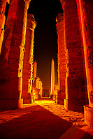 Illuminated columns and obelisk, Karnak Temple, Luxor, Egypt
