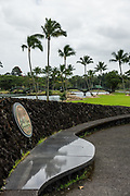 """In Wailoa River State Recreation Area, the Shinmachi Tsunami Memorial remembers locals who died in tsunamis that hit the Big Island. The memorial was designed by Tadashi Sato who titled it """"Submerged Rocks and Water Reflections."""" It's at the end of Piopio Street in Hilo, on the Big Island, Hawaii, USA."""