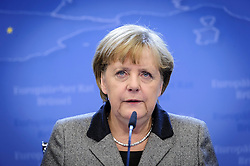 Angela Merkel, Germany's chancellor, speaks during her press briefing, just after 02:00 Friday morning, as the first day of EU Summit meetings stretches into the next day, at the European Council headquarters in Brussels, Belgium on Friday, Dec. 14, 2012. (Photo © Jock Fistick)