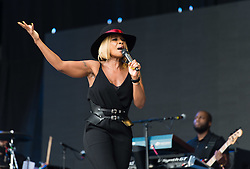 © Licensed to London News Pictures. 26/06/2015. Pilton, UK.  Mary J Blige performing on the The Pyramid Stage stage at Glastonbury Festival 2015 on Friday Day 3 of the festival.  This years headline acts include Kanye West, The Who and Florence and the Machine, the latter being upgraded in the bill to replace original headline act Foo Fighters.   Photo credit: Richard Isaac/LNP