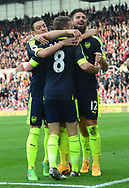 Olivier Giroud of Arsenal ® celebrates with teammates after he scores his teams 4th goal. Premier league match, Stoke City v Arsenal at the Bet365 Stadium in Stoke on Trent, Staffs on Saturday 13th May 2017.<br /> pic by Bradley Collyer, Andrew Orchard sports photography.