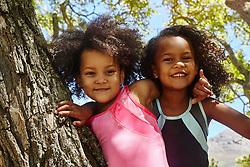 February 19, 2017 - Portrait of two young sisters, climbing tree (Credit Image: © Cultura via ZUMA Press)