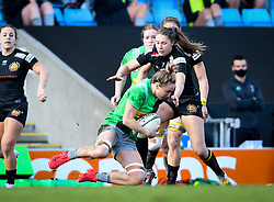 Lottie Holland of Exeter Chiefs attempts a tackle on Bethan Dainton of Harlequins - Mandatory by-line: Andy Watts/JMP - 06/02/2021 - Sandy Park - Exeter, England - Exeter Chiefs Women v Harlequins Women - Allianz Premier 15s
