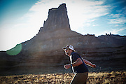 SHOT 10/16/16 5:51:21 PM - Doug Starkey of Steamboat, Co. tossing horseshoes after riding all day on the White Rim trip. The White Rim is a mountain biking trip in Canyonlands National Park just outside of Moab, Utah. The White Rim Road is a 71.2-mile-long unpaved four-wheel drive road that traverses the top of the White Rim Sandstone formation below the Island in the Sky mesa of Canyonlands National Park in southern Utah in the United States. The road was constructed in the 1950s by the Atomic Energy Commission to provide access for individual prospectors intent on mining uranium deposits for use in nuclear weapons production during the Cold War. Four-wheel drive vehicles and mountain bikes are the most common modes of transport though horseback riding and hiking are also permitted.<br /> (Photo by Marc Piscotty / © 2016)