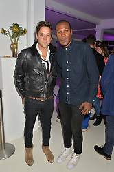 Left to right, JAMIE HINCE and TAFARI HINDS at the OFFtheGRID event - a solar-powered party on a London rooftop to support our renewable energy future hosted by Dame Vivienne Westwood supported by the Trillion Fund at 151-155 New North Road, London N1 on 4th September 2014.