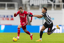 NEWCASTLE-UPON-TYNE, ENGLAND - Wednesday, December 30, 2020: Liverpool's captain Jordan Henderson (L) and Newcastle United's Joelinton Cássio Apolinário de Lira during the FA Premier League match between Newcastle United FC and Liverpool FC at St. James' Park. The game ended in a goal-less draw. (Pic by David Rawcliffe/Propaganda)