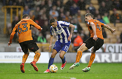 Brighton & Hove Albion's Anthony Knockaert (centre) takes on Wolverhampton Wanderers' David Edwards (right) and Andreas Weimann during the Sky Bet Championship match at Molineux, Wolverhampton.