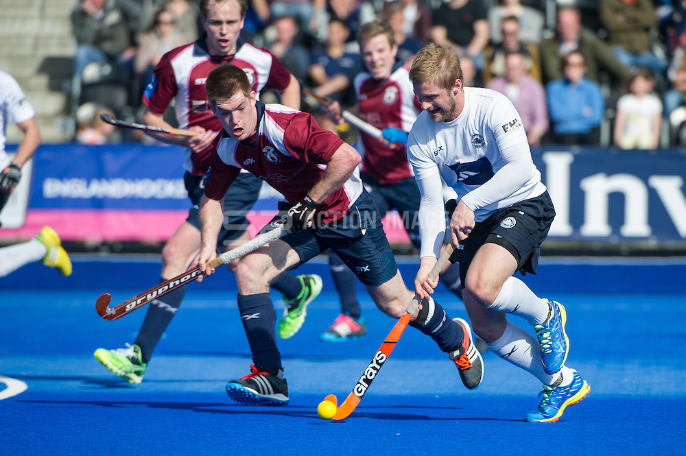 East Grinstead's Ashley Jackson is watched by Henry Weir of Wimbledon. East Grinstead v Wimbledon -  Now: Pensions Men's Hockey League Championship Final, Lee Valley Hockey & Tennis Centre, London, UK on 12 April 2015. Photo: Simon Parker