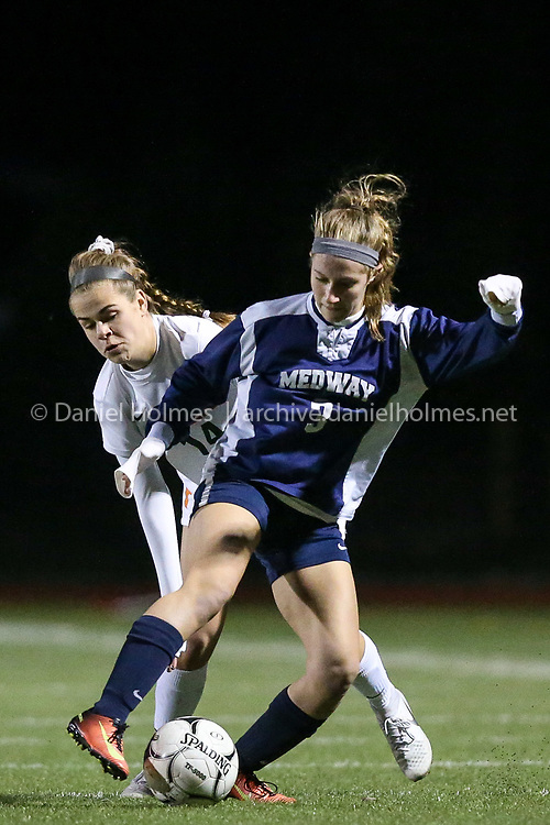 (11/10/18, SOMERSET, MA) Medway's Heather Scheid steals the ball from Hopkinton's Meredith Cesnek during the Division 2 South semifinals at Somerset-Berkley High School in Somerset on Saturday. [Daily News and Wicked Local Photo/Dan Holmes]