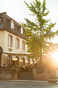 People sitting at restaurant during sunset, Trier, Germany
