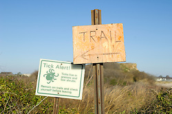 Warning sign For ticks and trail sign in Montauk,NY