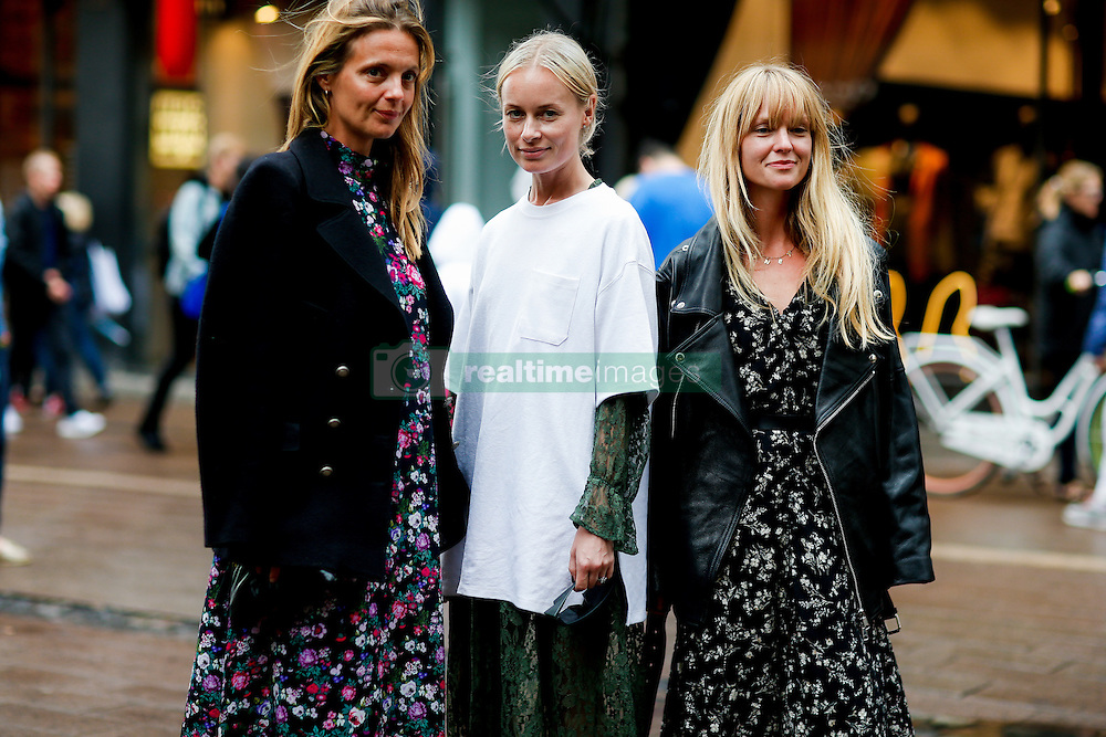 Street style, Thora Valdimars (middle) and Jeanette Friis Madsen (right) arriving at Fonnesbech Spring Summer 2017 show held at Nikolaj Plads, in Copenhagen, Denmark, on August 10, 2016. Photo by Marie-Paola Bertrand-Hillion/ABACAPRESS.COM