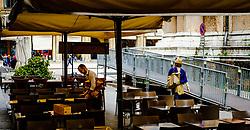 A waiter setting up tables in a restaurant in Bologna, Italy<br /> <br /> (c) Andrew Wilson | Edinburgh Elite media