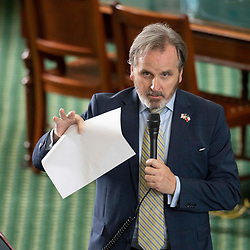 Texas Senate action on Tuesday, May 18, 2021 showing Sen. Bryan Hughes, R-Mineola, on a voting rights bill.