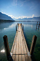 Photo of a pier overlooking scenic Lake Geneva in Montreux, Switzerland