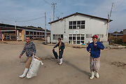Hiroto Mashiko, (left) the General manager of Minero Farm and Tokyo University gradute student Hiroki Masumoto (right) walk with another farm worker at the Minero Farm project near Koriyama, Fukushima, Japan Sunday November 22nd 2015 The Minero Farm is run by the NPO, Fukushima Agricultural Revitalizing Network (FAR-Net) and was intially sponsored by Danone. It aims to revitalise dairy farming in Fukushima through educational and training programmes.