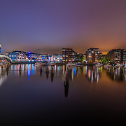 I have taken this panorama at 2 o'clock in the morning when a thick fog covered Trondheim.  You can see some haze lights in the distance. Solsiden is a modern shopping centre consisting of 60 shops, in the buildings of the old shipyard. By the dock outside, there is a large open air bar & restaurant afrea, which is very popular in the summer season, especially on sunny days