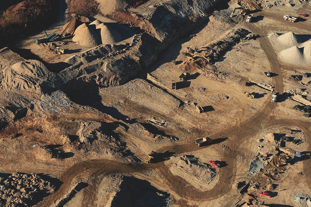 An aerial view of sand and gravel operation out side of Boston seen from a helicopter.