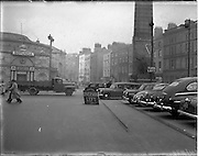13/11/1952<br /> 11/13/1952<br /> 13 November 1952<br /> Traffic scenes on O'Connell Street, Dublin. Gardai direct traffic near the Rotunda and Parnell Monument.