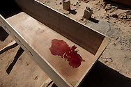 Blood left in a coffin from a man killed in the rebels first battle with Qadaffi loyalists.
