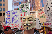 14 OCTOBER 2011 - PHOENIX, AZ:   A protester in front of the Chase Bank in Phoenix during the Occupy Phoenix march. About 300 people participated in the Occupy Phoenix march through downtown Phoenix Friday evening, Oct. 14. The march was the first event in the Occupy Phoenix protests which start with the occupation of Cesar Chavez Plaza, a large square in downtown Phoenix. PHOTO BY JACK KURTZ