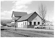 Durango depot without chimneys.  Some repair work has caused scaffolding to appear.  Some 1952 automobiles (Plymouth & Ford).<br /> D&RGW  Durango, CO  ca. 1953