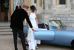 The newly married Duke and Duchess of Sussex, Meghan Markle and Prince Harry, leaving Windsor Castle after their wedding to attend an evening reception at Frogmore House, hosted by the Prince of Wales. The bride wore a ring which belonged to Diana, Princess of Wales. 19 May 2018 Pictured: newly married Duke and Duchess of Sussex, Meghan Markle and Prince Harry. Photo credit: Steve Parsons/WPA / MEGA TheMegaAgency.com +1 888 505 6342