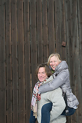 Man giving piggy back ride to woman, smiling, Bavaria, Germany