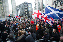 © London News Pictures. 26/02/2014. London, UK.  Supporters of far right groups gather outside the Old Bailey in London where Michael Adebolajo and Michael Adebowale are due to be sentenced for the murder of Fusilier Lee Rigby who was attacked near Woolwich Barracks in south-east London on May 22, 2013. Photo credit: Ben Cawthra/LNP