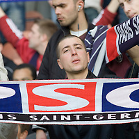 11 March 2007: A supporter of the french soccer team Paris Saint-Germain (PSG) Football Club holds a banner of the PSG prior to the French League 1 football game won 1-0 by AJ Auxerre FC over Paris Saint-Germain (PSG) at the Parc des Princes stadium, in Paris, France.