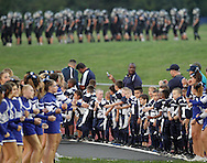 Wallkill youth football players and cheerleaders wait the for varsity team, in the background, to take the field before a game against Valley Central on Friday, Sept. 7, 2012.