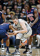 SHOT 2/14/13 8:46:33 PM - Colorado's Shane Harris-Tunks #15 looses control of the ball between Arizona's Angelo Chol #30 and Mark Lyons #2 during their regular season Pac-12 basketball game at the Coors Event Center on the Colorado campus in Boulder, Co. Colorado won the game 71-58. (Photo by Marc Piscotty / © 2013)