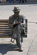 statue of Antoni Gaudi on bench in front of Casa de los Botines, Plaza San Marcelo, Leon spain castile and leon