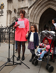 Alina Dulgheriu, 34, a representative for campaign group Be Here For Me, with her six-year-old daughter Sarah, speaks to the media outside the Royal Courts of Justice in London, after filing a High Court challenge against Ealing council over a ban on protesting outside a Marie Stopes clinic.