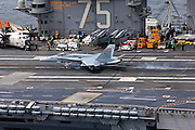 A Boeing F/A-18C Hornet, AC 210 164971 from VMFA-312 'Checkerboards' catches the arresting gear on the deck of CVN-75 USS Harry S. Truman.