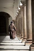 A monk walking in Interior del Convento de San Francisco - Quito, Ecuador, South America