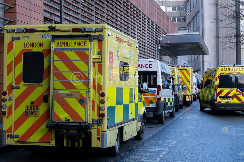 Ambulances waiting in line outside the Royal London Hospital in Whitechapel, which has become one of the main hospitals in London dealing with Covid-19 patients at the heart of the NHS battle against the pandemic as the national coronavirus lockdown three continues on 29th January 2021 in London, United Kingdom. It has been reported that queues of ambulances have been sees at many hospitals which are struggling to find beds due to the numbers of patients being brought in, with some patients being cared for in ambulances while they wait.
