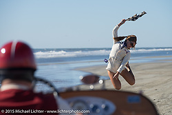 An enthusiiastic flag girl at the start of the Race of Gentlemen. on the wide beach of Wildwood, NJ, USA. October 11, 2015.  Photography ©2015 Michael Lichter.