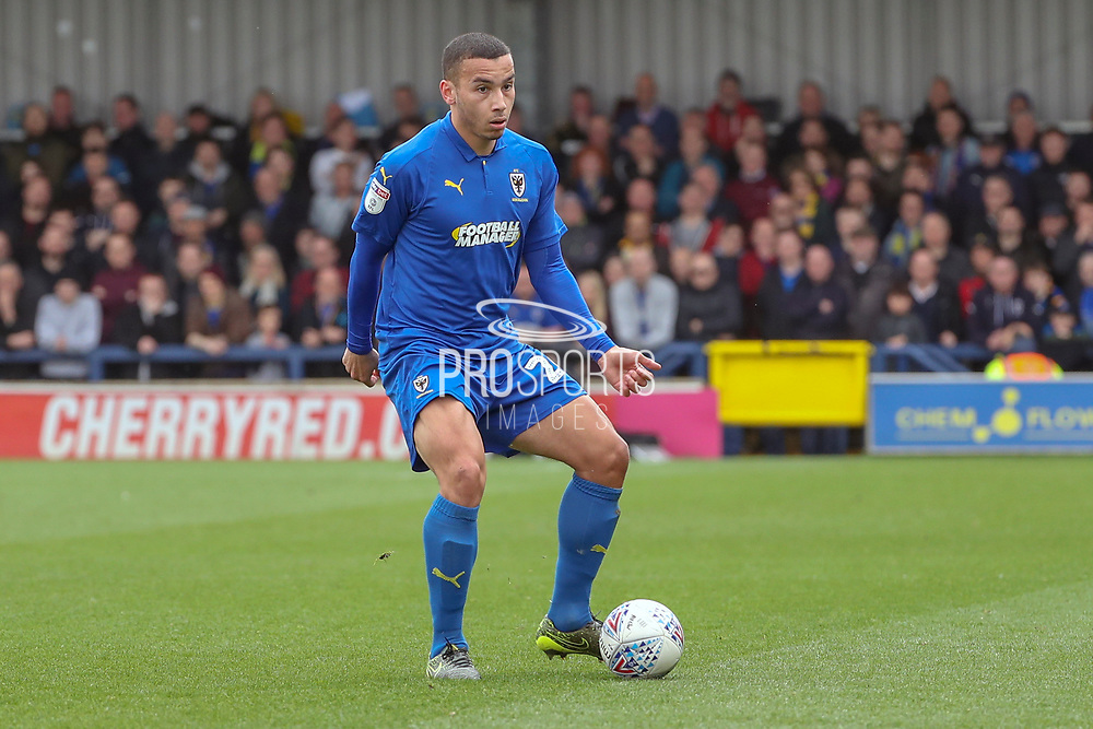 AFC Wimbledon defender Rod McDonald (26) passing the ball during the EFL Sky Bet League 1 match between AFC Wimbledon and Gillingham at the Cherry Red Records Stadium, Kingston, England on 23 March 2019.
