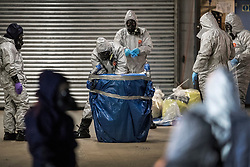 © Licensed to London News Pictures. 07/03/2018. Salisbury, UK. Police in protective suits and gas masks appear to be rehearsing search and evidence gathering techniques - possibly for a new search in Salisbury. Former Russian spy Sergei Skripal and his daughter were taken ill following a suspected poisoning in the city. The couple where found unconscious on bench in Salisbury shopping centre. Authorities now suspect a chemical nerve agent was used. Photo credit: Peter Macdiarmid/LNP