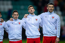 TALLINN, ESTONIA - Monday, October 11, 2021: Wales' (L-R) Connor Roberts, Chris Mepham and Kieffer Moore sing the national anthem before the FIFA World Cup Qatar 2022 Qualifying Group E match between Estonia and Wales at the A. Le Coq Arena. Wales won 1-0. (Pic by David Rawcliffe/Propaganda)