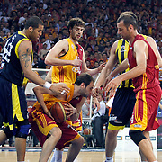 Galatasaray's Luksa ANDRIC (B), Caner TOPALOGLU (C) and Fenerbahce's Sean Gregory MAY (L) during their Turkish Basketball league Play Off Final fourth leg match Galatasaray between Fenerbahce Ulker at the Abdi Ipekci Arena in Istanbul Turkey on Saturday 11 June 2011. Photo by TURKPIX